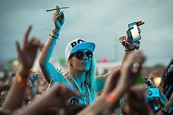 © Licensed to London News Pictures . 07/06/2014 . Heaton Park , Manchester , UK . A woman in the crowd during the show . Snoop Dogg performs on the Main Stage at the Parklife music festival in Heaton Park Manchester . Photo credit : Joel Goodman/LNP