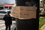 A sign is taped up at an intersection near the crime scene at Pulse, the LGBTQ night club where a mass shooter killed 49 and injured 53 others, in Orlando, Florida, U.S.