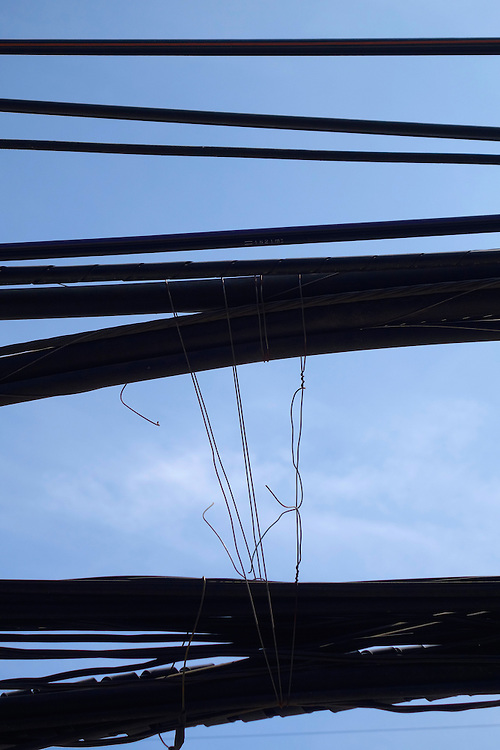 Electrical wires along the main street in Trat, Thailand.