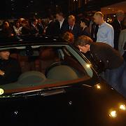 Presentatie nieuwe BMW modellen, Nance Coolen en vriend Pico van Sytzama