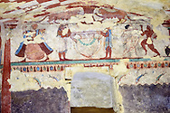 """Underground Etruscan tomb Known as """"Tomba delle Leonesse"""". A single chamber with double sloping ceiling decorated with a painted chequered design. Six painted columns divide the walls to give the tomb the appearance of a pavillion. In the typanium of the back wall are two lionesses below which is a large Krater used to mix water and wine, flanked by two musicians and a female dancer.  Circa 520 BC. Excavated 1874, Etruscan Necropolis of Monterozzi, Monte del Calvario, Tarquinia, Italy. A UNESCO World Heritage Site. .<br /> <br /> Visit our ETRUSCAN PHOTO COLLECTIONS for more photos to buy as buy as wall art prints https://funkystock.photoshelter.com/gallery-collection/Pictures-Images-of-Etruscan-Historic-Sites-Art-Artefacts-Antiquities/C0000GgxRXWVMLyc"""