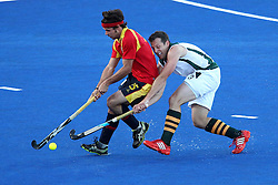 Pau Quemada of Spain battles with Andrew Cronje of South Africa during Pool MA Hockey  match between South Africa and Spain held at the Riverbank Arena in Olympic Park in London as part of the London 2012 Olympics on the 3rd August 2012..Photo by Ron Gaunt/SPORTZPICS