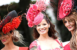 Katie Houghton (left), Natasha Smile, and Ilda di Vico during Ladies Day of the 2019 Invested Derby Festival at Epsom Racecourse, Epsom.