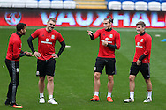 Gareth Bale of Wales (2nd right) jokes with Sam Vokes (2nd left) during the Wales football team training at the Cardiff city Stadium in Cardiff , South Wales on Saturday 8th October 2016, the team are preparing for their FIFA World Cup qualifier home to Georgia tomorrow. pic by Andrew Orchard, Andrew Orchard sports photography