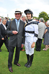 DELFINA FIGUERAS and JOHN DUNLOP at the 3rd day of the 2011 Glorious Goodwood Racing Festival - Ladies Day at Goodwood Racecourse, West Sussex on 28th July 2011.