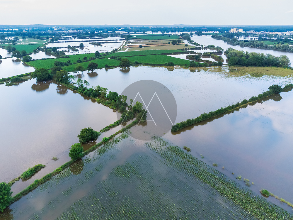 Aerial view of flooded farmland during a high water period in summer on floodplains of river Maas, Beugen, Noord-Brabant, The Netherlands.