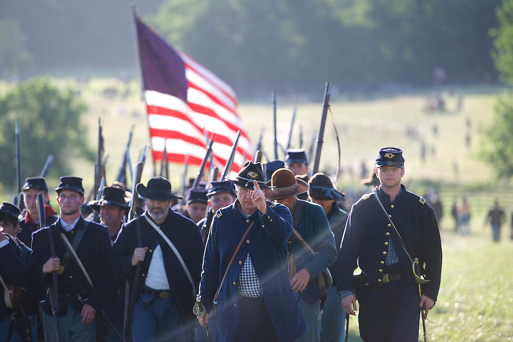 Union soldiers march off the field after staging a battle of Cemetery Hill on the third of a four day Gettysburg Anniversary Committee 150th Gettysburg reenactment in Gettysburg, PA on July 6, 2013.