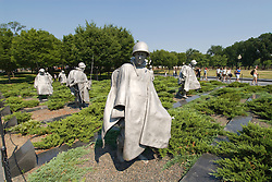 Washington DC; USA: The Korean War Veterans Memorial.  The statues of soldiers in a platoon march warily across a field..Photo copyright Lee Foster Photo # 9-washdc83279