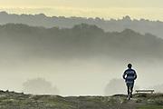 RICHMOND SURREY. A man jogs during an autumnal morning in Richmond Park, London. 02 October 2010