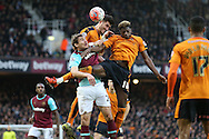 Nikica Jelavic of West Ham United is challenged by Dominic Iorfa (18) of Wolverhampton Wanderers and Danny Batth of Wolverhampton Wanderers (c).The Emirates FA cup, 3rd round match, West Ham Utd v Wolverhampton Wanderers at the Boleyn Ground, Upton Park  in London on Saturday 9th January 2016.<br /> pic by John Patrick Fletcher, Andrew Orchard sports photography.