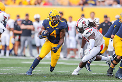 Oct 2, 2021; Morgantown, West Virginia, USA; West Virginia Mountaineers running back Leddie Brown (4) runs the ball during the third quarter against the Texas Tech Red Raiders at Mountaineer Field at Milan Puskar Stadium. Mandatory Credit: Ben Queen-USA TODAY Sports