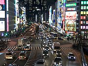 a major crossroad through the city at night Tokyo
