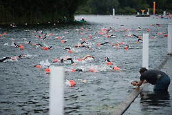 © Licensed to London News Pictures. 26/06/2011. Henley-on-Thames, UK. Swimmers take part in the Henley Swim at dawn this morning (26/06/2011). The annual event sees competitors swim the length of the 2.1km course of the Henley Royal Regatta on the River Thames, after arriving in darkness, and walking half a mile to the start at sunrise. See special instructions. Photo credit should read: Ben Cawthra/LNP