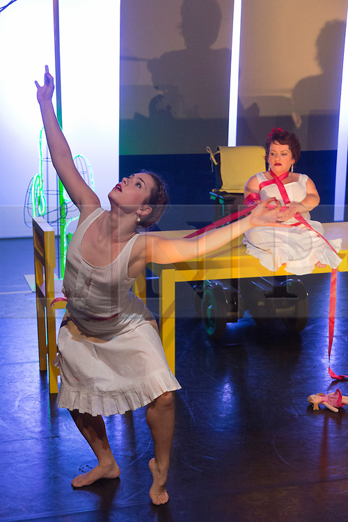 "© Licensed to London News Pictures. 05/10/2015. London, UK. Pictured: Nicole Guarino and Caroline Bowditch. Caroline Bowditch's ""Falling in Love with Frida"" explores the life, loves and legacy of disabled artist Frida Kahlo at the Lilian Baylis Studio/Sadler's Wells on 5-6 October 2015. Performed by Caroline Bowditch, Welly O'Brien, Nicole Guarino and Yvonne Strain (sign language interpreter). Photo credit: Bettina Strenske/LNP"