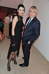 NICK RHODES and NEFER SUVIO at a dinner in aid The Journalism Foundation held at Philips De Pury & Company, Howick Place, London, SW1 on 22nd May 2012.
