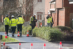 © London News Pictures. 15/02/2014. Hemel Hempstead, UK.  An investigation team at the scene where a giant sinkhole measuring 35ft wide by 20ft deep has opened up next to a house in Hemel Hempstead, Hertfordshire.  Photo credit: Ben Cawthra/LNP