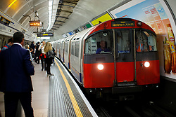 © Licensed to London News Pictures. 23/05/2016. London, UK. Commuters wait for a Piccadilly line train at King's Cross Underground station in London on 23 May 2016. The long-awaited 24-hour weekend service is officially announced to begin on 19 August 2016 on the Central and Victoria lines, with the Piccadilly, Jubilee and Northern to follow in the autumn. Photo credit: Tolga Akmen/LNP