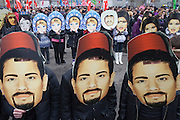 """Moscow, Russia, 04/11/2011..On Russian National Unity Day members of the pro-Kremlin youth group """"Nashi"""" hold their own Russian March to counter the racist and xenophobic sentiments of the nationalist Russian March held on the same day for the last several years. Demonstrators wore masks of images of various Russian ethnic groups in a call for national unity and ethnic harmony."""