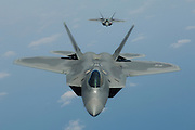 F-22As head on