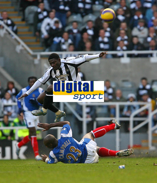 Photo: Andrew Unwin.<br /> Newcastle United v Portsmouth. The Barclays Premiership. 26/11/2006.<br /> Newcastle's Obafemi Martins (top) hurdles a challenge from Portsmouth's Sol Campbell (bottom).