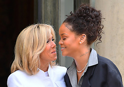 Barbadian singer and Global Ambassador for the Global Partnership for Education Rihanna is welcomed by French First Lady Brigitte Macron at the Elysee Palace ahead of a meeting with French President Emmanuel Macron in Paris, France on July 26, 2017. Photo by Christian Liewig/ABACAPRESS.COM