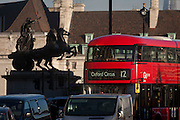 Commuters on a number 12 London bus to Oxford Circus travels through Westminster, passing the statue of Iceni tribe leader Boudicca, on 18th January 2017, in Parliament Square, London England.