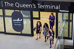 © Licensed to London News Pictures. 04/06/2014. LONDON, UK. London Heathrow's new Terminal 2 opens to passengers on Wednesday, 4 June 2014. The new terminal has 60 check-in gates and 66 self-check-in kiosks, 29 security lanes, 33 shops and 17 restaurants. On the first day of operation, airport welcomed 34 United flights for the US. Photo credit : Tolga Akmen/LNP
