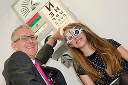 At the opening of his new Optometrists in Preston on Saturday  Mike Broadhurst gives Lauren Powell an eyetest awareness test to demonstrate the importance of eye checks for children. ..18 August 2012.Image © Paul David Drabble