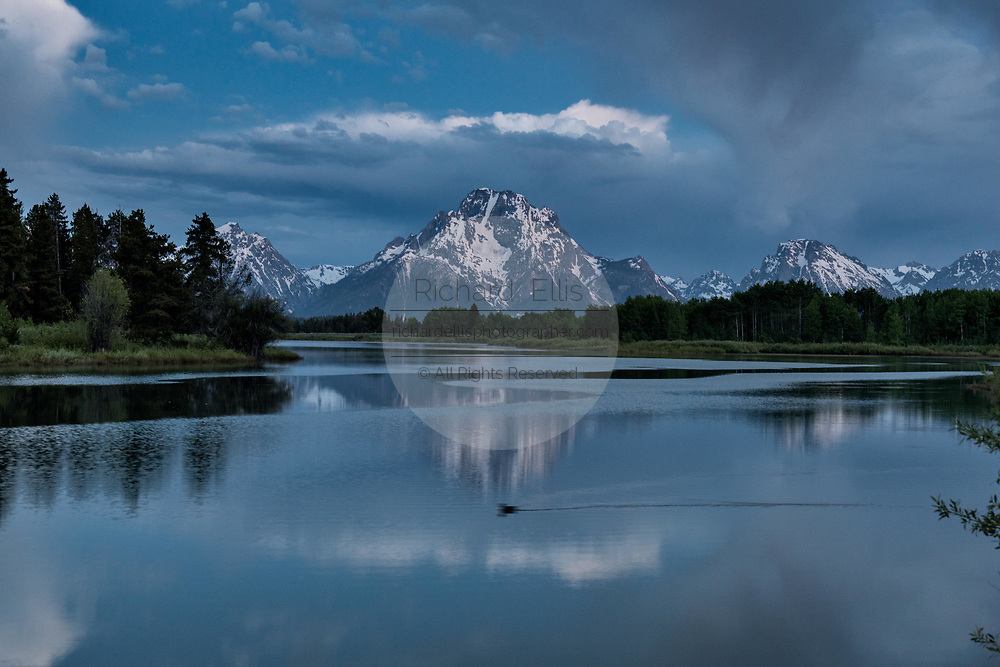 Mount Moran and the Grand Teton mountains reflected on the Snake River at Oxbow Bend in pre-dawn at the Grand Teton National Park in Moran, Wyoming.