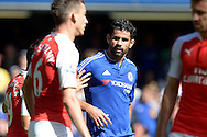 Diego Costa of Chelsea looks on at Gabriel of Arsenal who gets sent off after their pushing and shoving. . Barclays Premier League match, Chelsea v Arsenal at Stamford Bridge in London on Saturday 19th September 2015.<br /> pic by John Patrick Fletcher, Andrew Orchard sports photography.