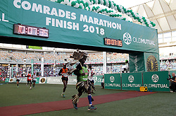 10062018 (Durban) Abel wearing a traditional clothes pass the finnish line at the Mosses Mabhida stadium venue during the Comrades Marathon on Sunday as Bong'musa Mthembu and Ann Ashworth ensured that the coveted titles remained on these shores.<br /> Picture: Motshwari Mofokeng/African News Agency/ANA