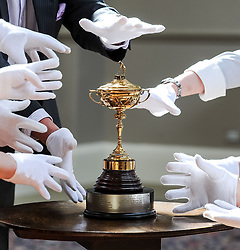 Many hands try to get to the replica Ryder Cup presented to Sergio Garcia in 2001,  which is expected to fetch up to £8000 GBP in Bonham's sporting goods sale.<br /> <br /> © Dave Johnston/ EEm