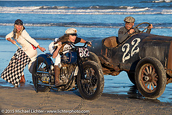 Brittney Olsen on the One of One Harley-Davidson (built by her husband Matt for Michael Detwiler)alongside Bobby Green in his  Overland Whippet with Jessi Combs as the Flag Girl as they all pose for painter David Uhl at The Race of Gentlemen. Wildwood, NJ, USA. October 11, 2015.  Photography ©2015 Michael Lichter.
