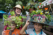 Festival goers wearing living hats. Totally Thames takes place over the whole month in September, combining arts, cultural and river events presented by Thames Festival Trust throughout the 42-mile stretch of the River Thames in London, UK.