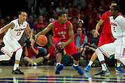 DALLAS, TX - JANUARY 4: Sterling Brown #3 of the SMU Mustangs brings the ball up court against the Connecticut Huskies on January 4, 2014 at Moody Coliseum in Dallas, Texas.  (Photo by Cooper Neill) *** Local Caption *** Sterling Brown