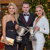 Stan Lineen with Lisa Glynn and Moirah Lineen with the County and Munster cups
