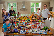 The Glad Ostensen family in Gjerdrum, Norway. Anne Glad Fredricksen, 45, her husband Anders Ostensen, 48, and their three children, Magnus, 15, Mille 12, and Amund, 8 with their typical week's worth of food in June. Food expenditure for one week: 4265.89 Norwegian Kroner;  $731.71 USD. Model-Released.