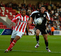 Photo: Ed Godden.<br /> Cheltenham Town v Bristol City. Carling Cup. 22/08/2006.<br /> Gavin Caines (L) is challenged by Bristol's Phil Jevons.