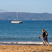 Couple Walking on Kamaole Beach in Kihei on the island of Maui in Hawaii