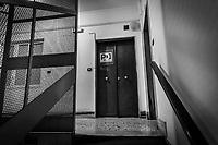 SALERNO (SA) - 3 FEBBRAIO 2018: La porta d'ingresso alla sede del Partito Democratico di Salerno, città amministrata per 18 anni (dal 1993 al 2011) dall'attuale governatore della Regione Campania Vincenzo De Luca (Partito Democratico), il 3 febbraio 2018.<br /> <br /> Le elezioni politiche italiane del 2018 per il rinnovo dei due rami del Parlamento – il Senato della Repubblica e la Camera dei deputati – si terranno domenica 4 marzo 2018. Si voterà per l'elezione dei 630 deputati e dei 315 senatori elettivi della XVIII legislatura. Il voto sarà regolamentato dalla legge elettorale italiana del 2017, soprannominata Rosatellum bis, che troverà la sua prima applicazione<br /> <br /> ###<br /> <br /> SALERNO, ITALY - 3 FEBRUARY 2018: The entrance door to the headquarters of the Democratic Party (PD / Partito Democratico) of Salerno, a city governed for 18 years by Vincenzo De Luca (Democratic Party / Partito Democratico), currently President of the Campania region, in Salerno, Italy, on February 3rd 2018.<br /> <br /> The 2018 Italian general election is due to be held on 4 March 2018 after the Italian Parliament was dissolved by President Sergio Mattarella on 28 December 2017.<br /> Voters will elect the 630 members of the Chamber of Deputies and the 315 elective members of the Senate of the Republic for the 18th legislature of the Republic of Italy, since 1948.