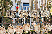 Traditional popcorn berry Christmas wreaths made by Gullah basket weavers on sale along Meeting Street in Charleston, SC.