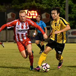 BRISBANE, AUSTRALIA - APRIL 13: Scott Bow of Olympic FC and Kyusub Bang compete for the ball during the NPL Queensland Senior Men's Round 4 match between Olympic FC and Moreton Bay Jets at Goodwin Park on April 13, 2017 in Brisbane, Australia. (Photo by Patrick Kearney/Olympic FC)