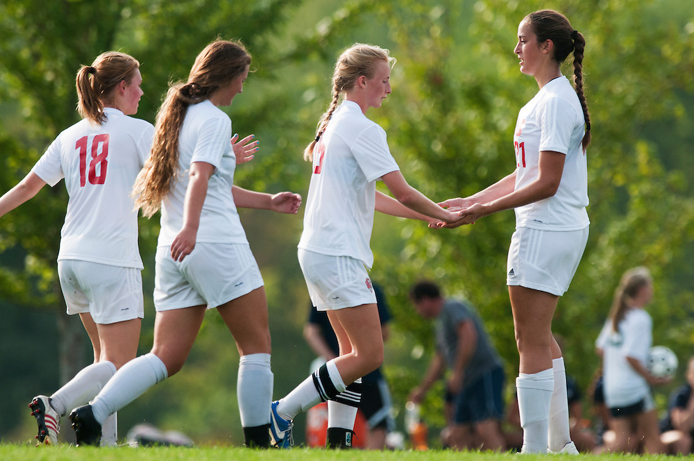 CVU celebrates a goal during the girls varsity soccer game between the Burlington Seahorses and the Champlain Valley Union Redhawks at CVU High School on Tuesday afternoon September 8, 2015 in Hinesburg. (BRIAN JENKINS/for the FREE PRESS)