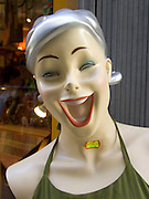 a display mannequin with a very big smile on her face