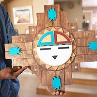 Davis Coonis, Zuni Pueblo Artwalk featured artist holds up a Zuni Sunface piece during a visit to his home, Thursday, Oct. 24 in Zuni Pueblo.