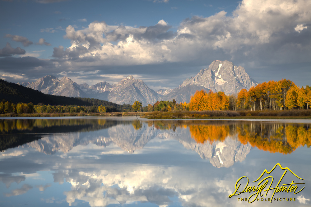 Fall Colors reflected in the waters of the Oxbow Bend in Grand Teton National Park<br />