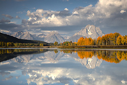"""Fall Colors reflected in the waters of the Oxbow Bend in Grand Teton National Park<br /> <br /> For production prints or stock photos click the Purchase Print/License Photo Button in upper Right; for Fine Art """"Custom Prints"""" contact Daryl - 208-709-3250 or dh@greater-yellowstone.com"""