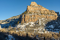 The snow-covered cliffs of Ten Sleep Canyon glow in the evening sunlight.