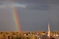 Middletown, N.Y. - A bright rainbow is visible in the clouds near the steeple of St. Joseph's Church after a spring shower on April 13, 2006.