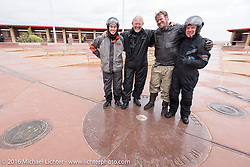 Left to right - Eric Trapp and his father Thomas Trapp from Frankfurt Germany, Ryan Allen of New Mexica and Paul Jung of Germany at Four Corners (the meeting of Utah, Colorado, New Mexico and Arizona) during the Motorcycle Cannonball Race of the Century. Stage-11 ride from Durango, CO to Page, AZ. USA. Wednesday September 21, 2016. Photography ©2016 Michael Lichter.